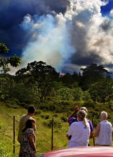 People viewing the smoke rising from Kilauea June 27th lava flow near the Pahoa Transfer Station on Cemetary Road Saturday (Sept 13).  According to the USGS/HVO the spot where I shot this from will be flowed-over in the coming weeks should the lava continue. Photography by Baron Sekiya | Hawaii 24/7