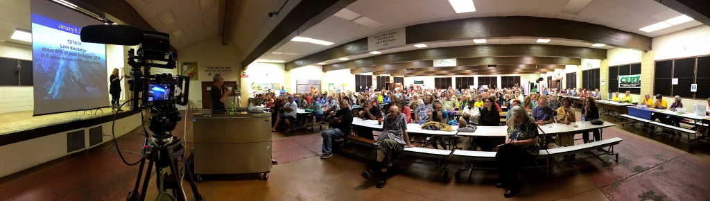 Live streaming rig and the crowd in the Pahoa High School Cafeteria for the community lava flow update meeting held by Hawaii County and the U.S. Geological Survey's Hawaiian Volcano Observatory.