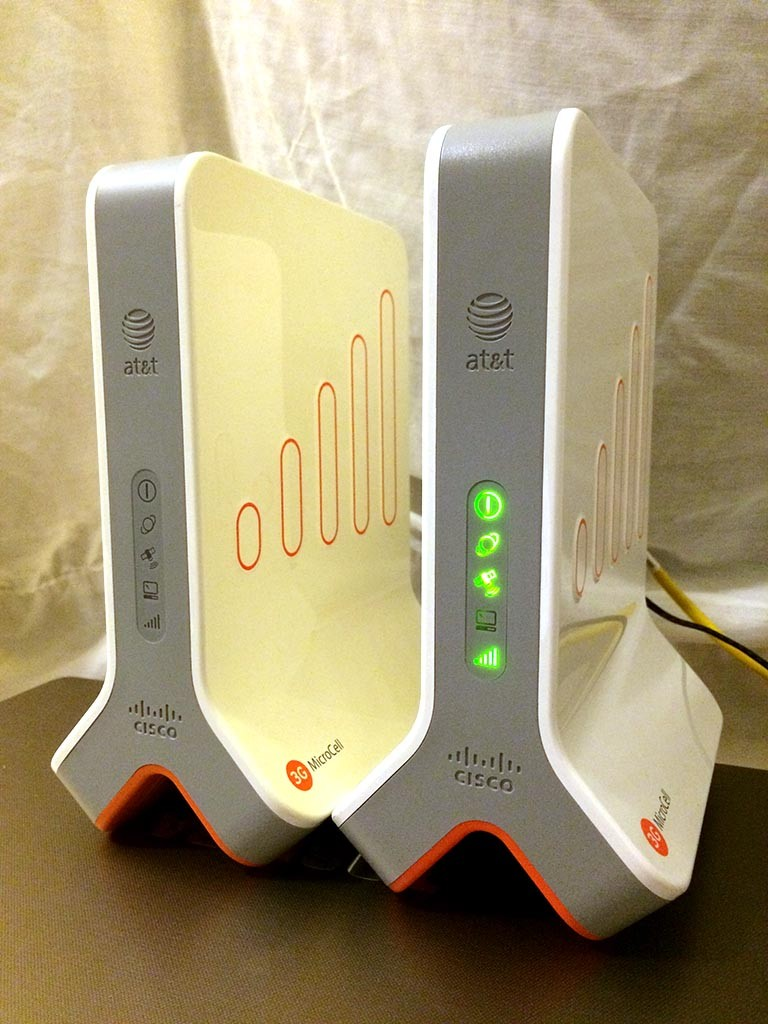 A pair of AT&T first generation MicroCells. The one on the right is activated.