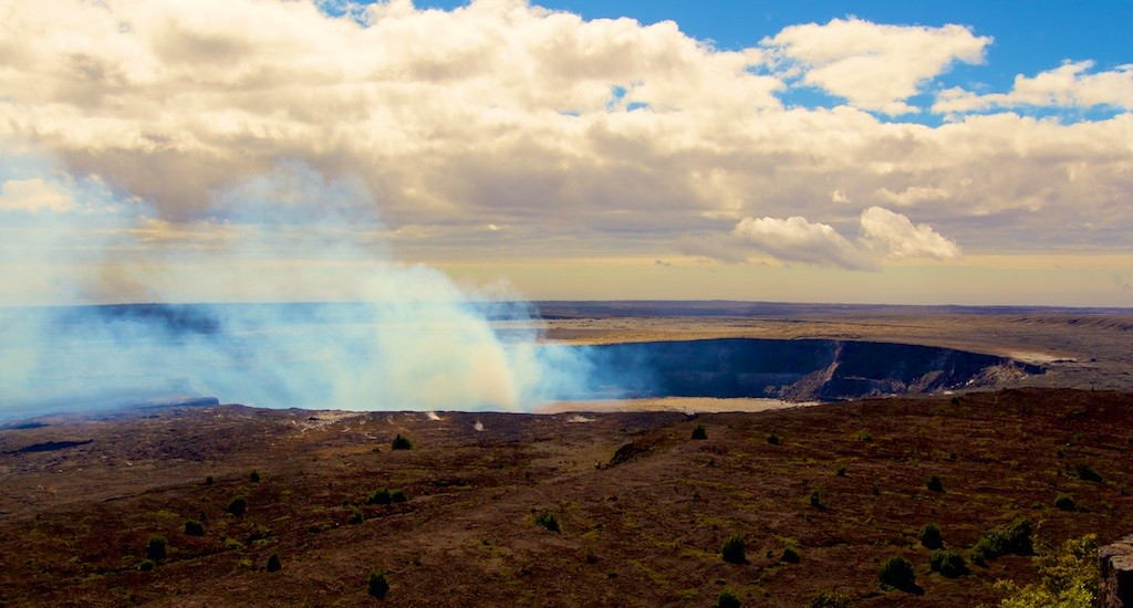 The Halemaumau Overlook Vent smoking away on Kilauea Thursday morning, January 1, 2015. With the mild morning temperature and winds from the Southeast the fumes were pushing North over the landscape instead of rising straight up. Photo by Baron Sekiya