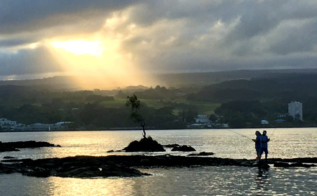 Sunbeams on the slopes of the mauna at Hilo Bay near sunset. Photo by Baron Sekiya